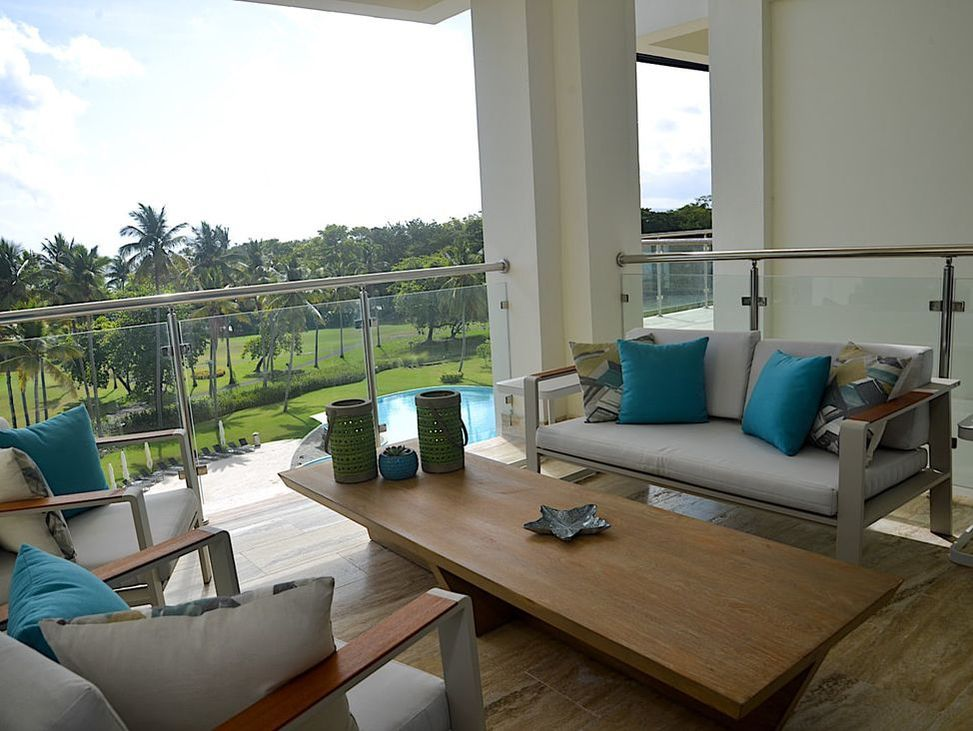 A private balcony overlooking the on-site golf course